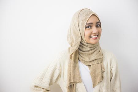 head scarf: portrait of pretty oung asian muslim woman in head scarf smile