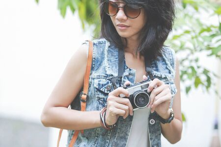 young asian: stylish young woman with vintage retro camera