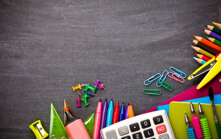 School supplies on blackboard background ready for your design Stock Photo - 57127673