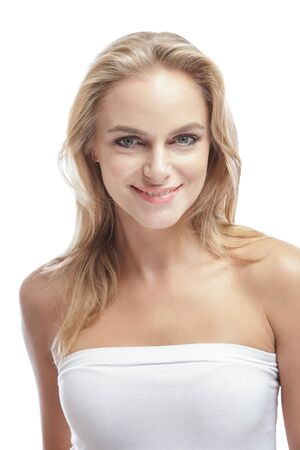 blondie: portrait of beautiful blonde girl smiling isolated on white background Stock Photo