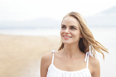 beautiful sky: portrait of beautiful woman enjoying summer on the beach with copy space