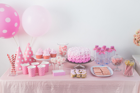 portrait of birthday party supplies. sweet corner with cake, lollies, cookies and candy Stok Fotoğraf