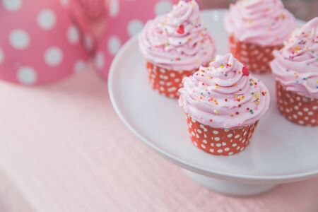 sugarpaste: close up of a pink cupcake at birthday party