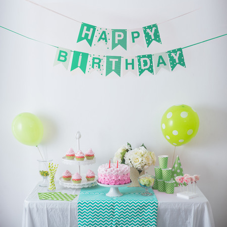 portrait of Birthday party decoration with full of cake and sweet candy