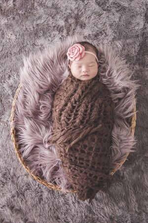 comfy: full body portrait of little baby girl sleeping comfy on fur blanket