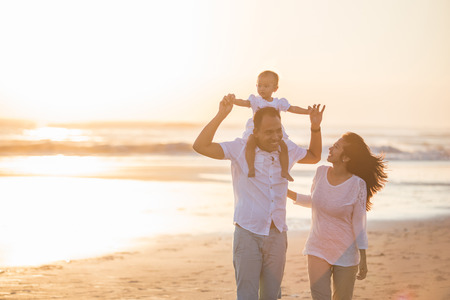 portrait of happy family and baby enjoying sunset in the summer leisure Stok Fotoğraf