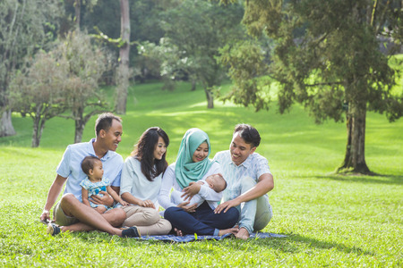 portrait of two young asian Family in the park enjoying spring together Stock Photo