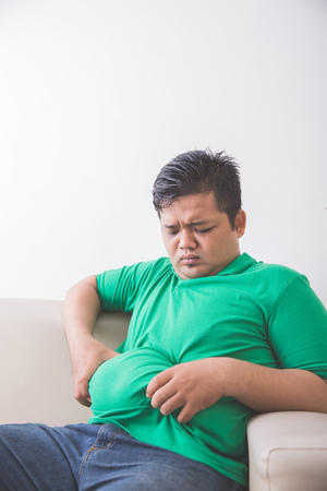 Portrait of Fat obese man thinking about his weight problem Stock Photo