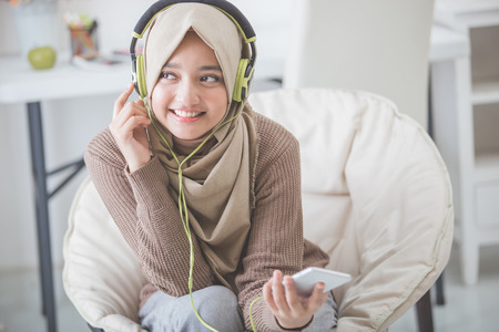 portrait of beautiful asian woman enjoying music