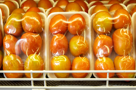 portrait of fresh tomatoes in a package at supermarket Stock Photo