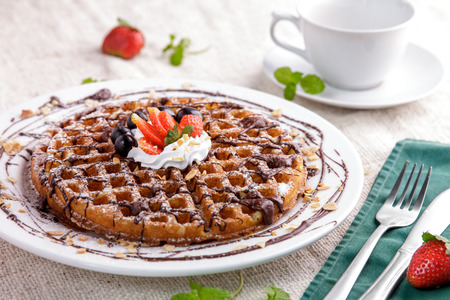 dessert topping: portrait of homemade waffle with chocolate, strawberry, and cream topping for dessert
