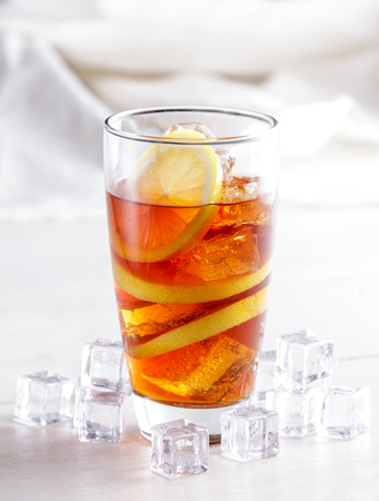 tall: portrait of a glass of ice lemon tea with lemon slice and ice cubes Stock Photo
