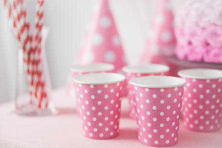 party background: party pink paper glass on a table. sweet corner concept