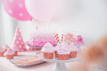 pink cake: close up of a cupcake at sweet corner on pink birhtday party theme Stock Photo