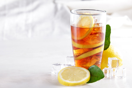 portrait of fresh ice lemon tea with lemon slice and ice cubes with copy space