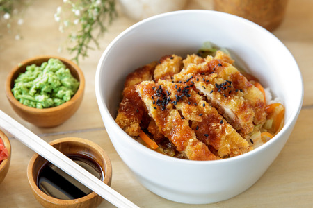 portrait of japanese food chicken katsu don served with soy sauce and wasabi