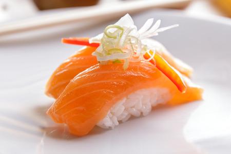 close up portrait of japanese food nigiri salmon sushi on white plate