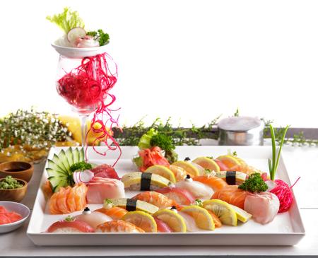japanese food: portrait of japanese food nigiri sushi platter on white plate with garnish isolatede on white background