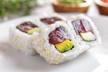 maki: portrait of japanese food tuna avocado maki sushi with wasabi and pickled ginger