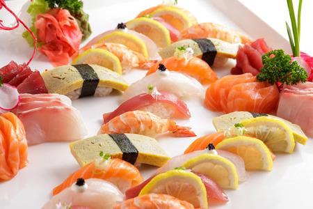 nigiri: portrait of various of nigiri sushi on white plate