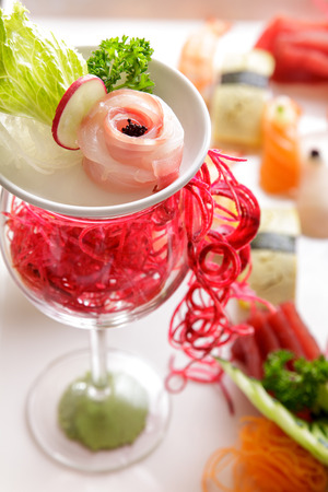 close up portrait of garnish on sashimi platter using glass