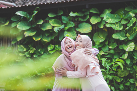 group of attractive asian woman with hijab together. best friend hugs each other Stok Fotoğraf