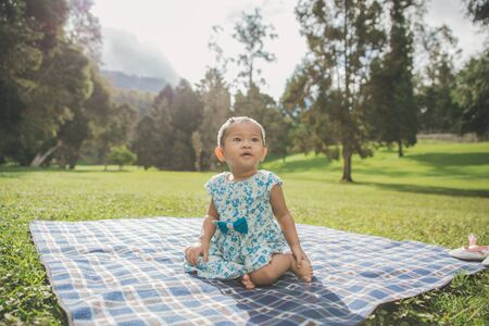 citypark: portrait of Happy baby sitting in the park Stock Photo