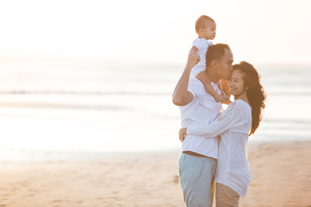 portrait of happy happy family at the beach loving and embracing Фото со стока