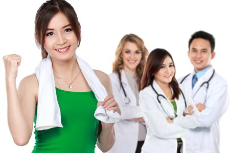 excited woman doing exercise while her team of doctor standing at the background
