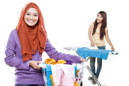 portrait of attractive asian housewife doing some laundry