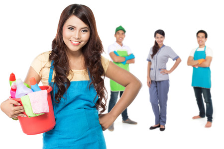 chores: group of professional cleaning services and housewife ready to do the chores Stock Photo