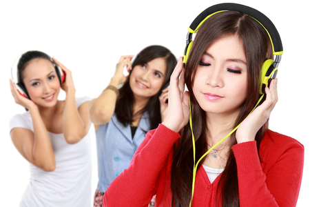 group of young people enjoying music with headphones photo