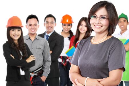 portrait of businesswoman with group of professional worker at the background photo