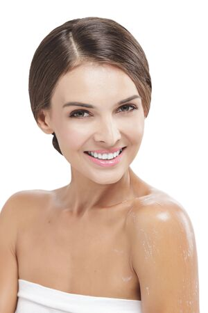 beautiful woman body: portrait of beautiful woman smiling with some body lotion on her arms isolated on white background Stock Photo