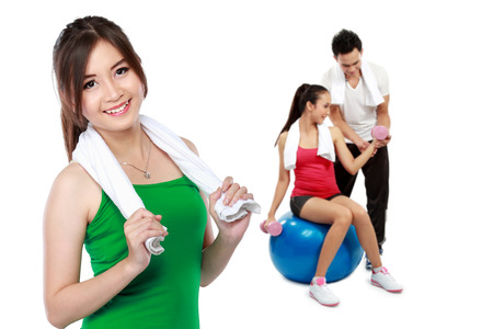 male and female friends doing exercise together at the gym photo