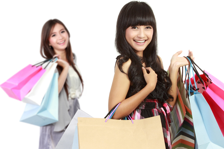attractive woman with shopping bag. her friends at the background photo