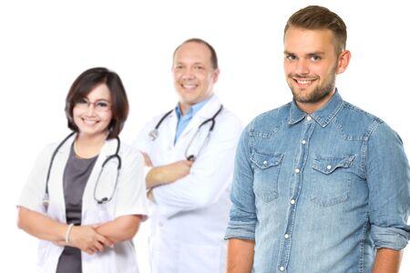 portrait of happy patient standing in front of his doctor photo