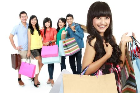 group of happy people shopping with paper bag photo