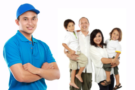 portrait of professional home moving services standing in front of a family photo