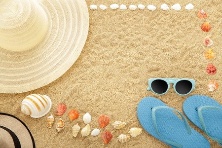 top view portrait of beach accesories on sands with copy space