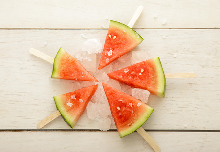 top view of watermelon popsicle summer fruit dessert on white wooden board Stock Photo