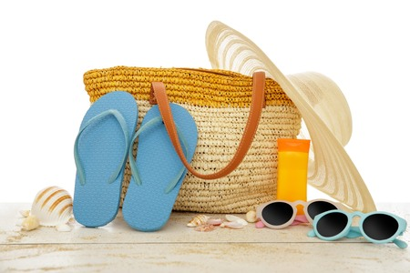 portrait of beach accessories on for summer vacation on white wooden table isolated on white background