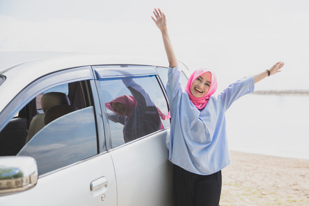 portrait of happy woman traveling with a car during summer holiday