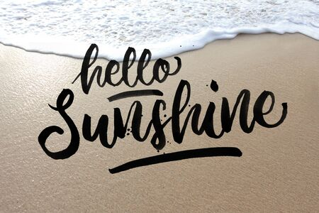 portrait of the sand and water with quote Hello Sunshine