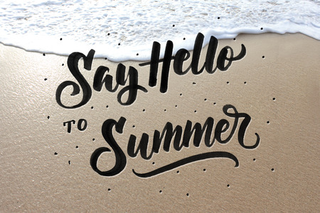 say hello to summer quote. modern lettering written on sand