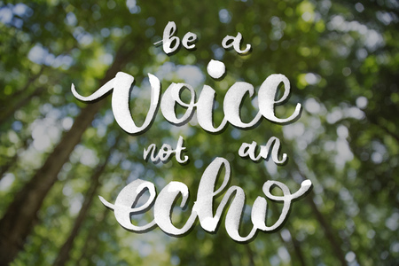 A portrait of sunbeam between tress, bokeh background with quote be a voice not an echo
