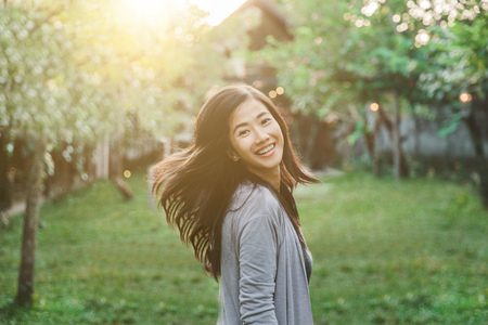 portrait of happy attractive asian woman smiling to camera photo