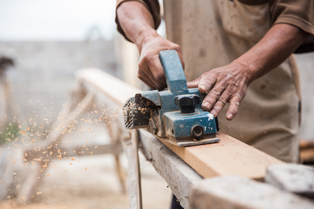 close up of a worker grinds the wood Stock Photo
