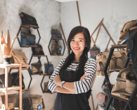 portrait of asian business owner standing in front of her bag store Stock Photo
