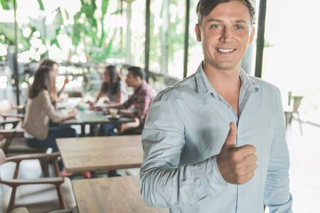 portrait of team leader showing thumb up after meeting